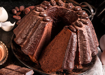 Sweet chocolate cake with cacao topping and shiny glazing