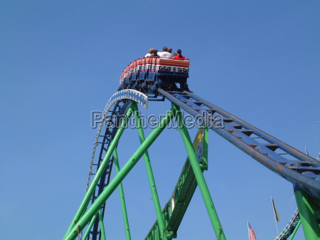 people in roller coaster