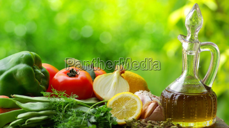 oil olive with vegetables and condiments