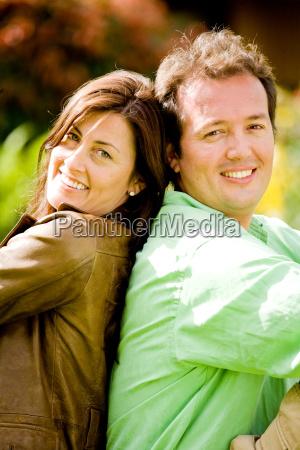 happy couple portrait back to