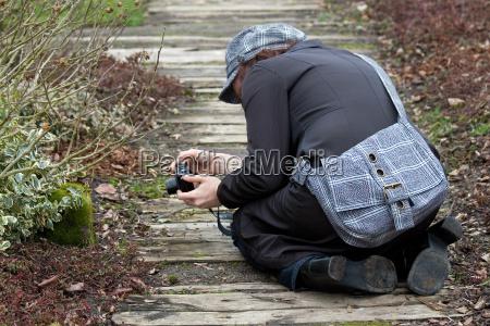 kneeling photographer