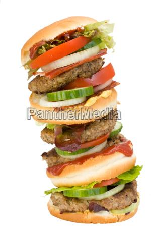 vierfacher hamburger isoliert auf weiss