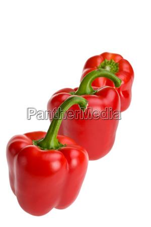 drei rote paprika s in einer