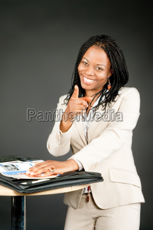 businesswoman points with finger