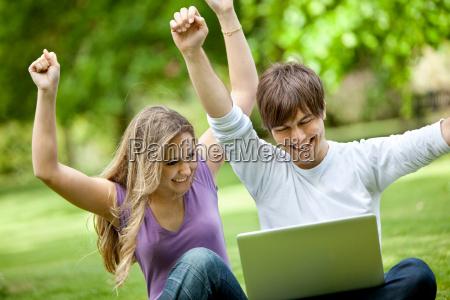 happy couple with laptop