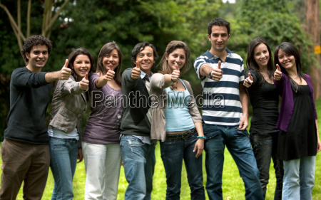 large group of friends with thumbs