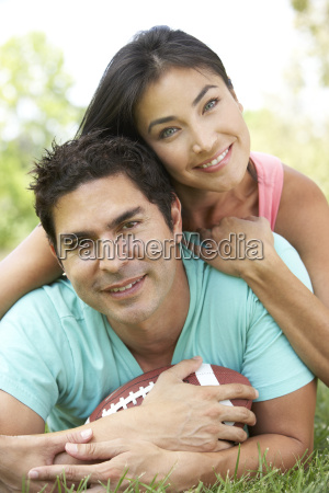 couple in park with american football