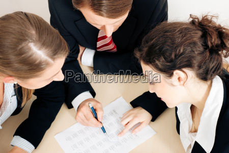 business people working on document