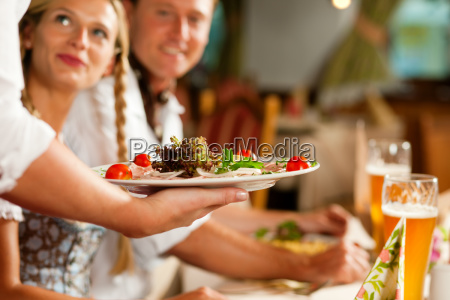 waitress serving in bavarian pub