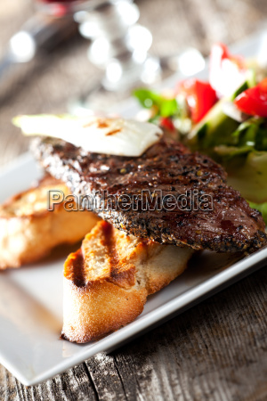 detail of a steak with salad