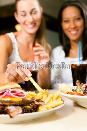 restaurant woman women fastfood hamburger burger