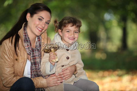 mother and daughter gathering mushroom
