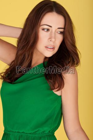 sexy woman in emerald green dress