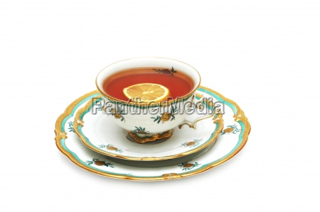tea with lemon and saucers isolated