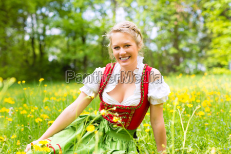 young woman in traditional dirndl on