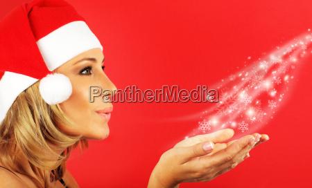happy santa girl blowing a kiss