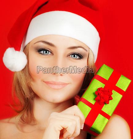 happy santa girl holding christmas gift