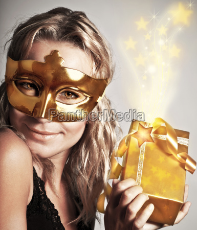 stylish woman with golden mask and