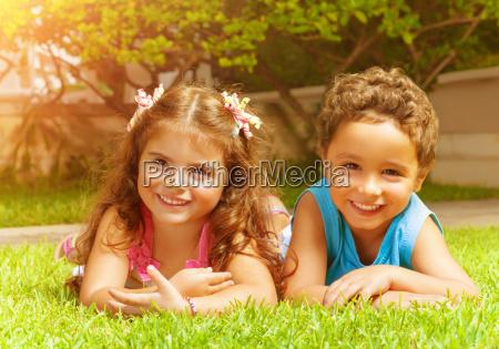 happy kids on green grass