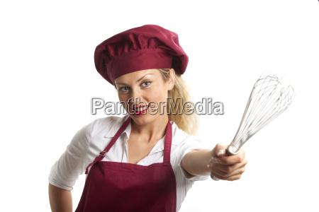 weiblichen chef mit einem schneebesen