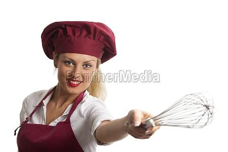 weibliche koch mit einem schneebesen