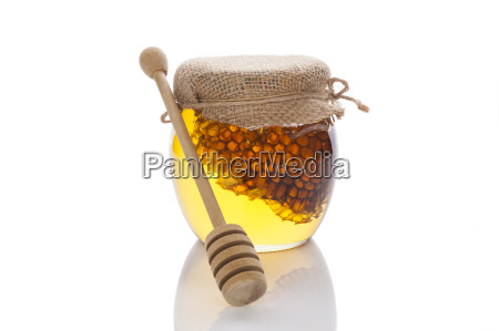 honey jar with wooden dipper