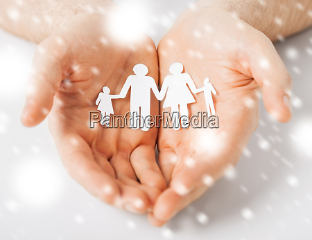 man hands showing family of paper