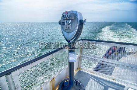 binoculars watching at horizon on ship