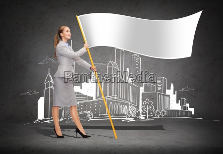 smiling woman holding flagpole with white