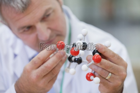 close up of chemical engineer examining