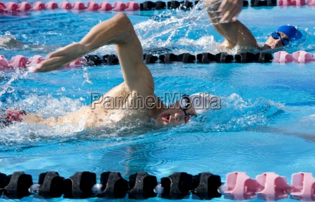 young men competing in swimming race