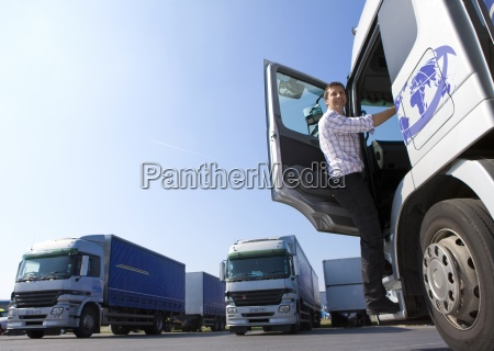 truck driver climbing in to cab