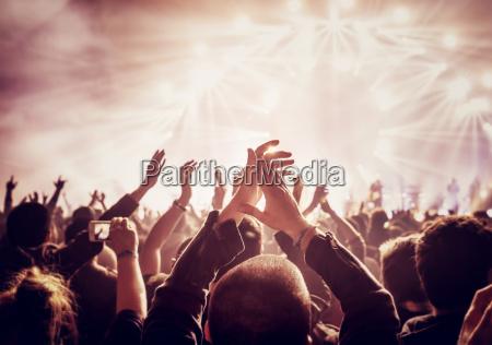 large group of people enjoying concert