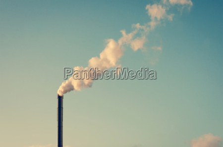 factory with smoking chimney
