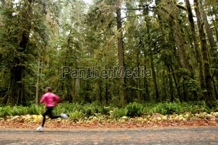 a female jogging down a road