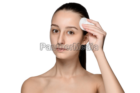 skin care woman removing face with