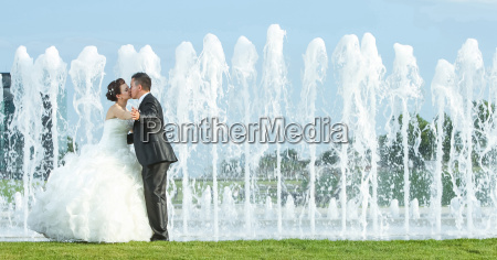 bride and groom kissing in front