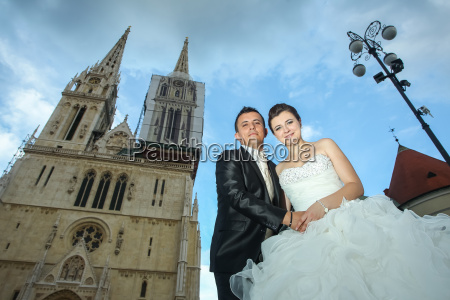 low angle view of newlyweds posing