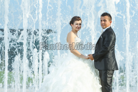 married couple in front of water