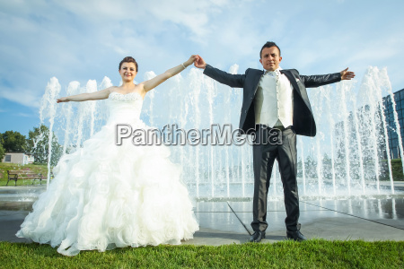 maried couple holding hands in front