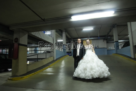 newlyweds standing in garage