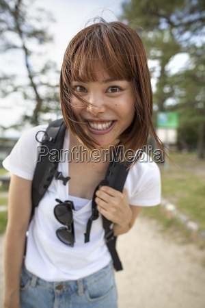 young woman in the park carrying
