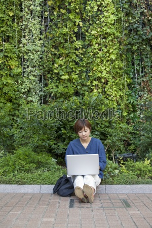 a woman with a laptop sitting
