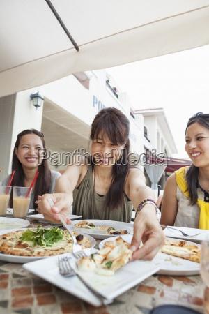 three women enjoying a meal