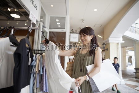 woman looking at clothing in a