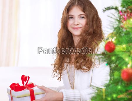 happy girl with christmas gift