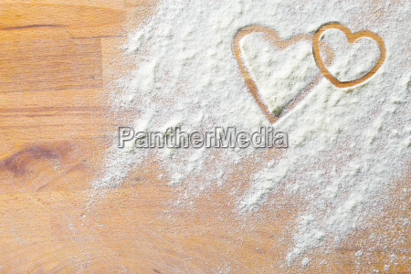 hearts of flour on wooden table