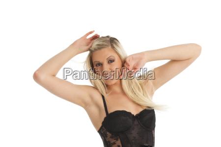blonde frau in unterwaesche auf weiss