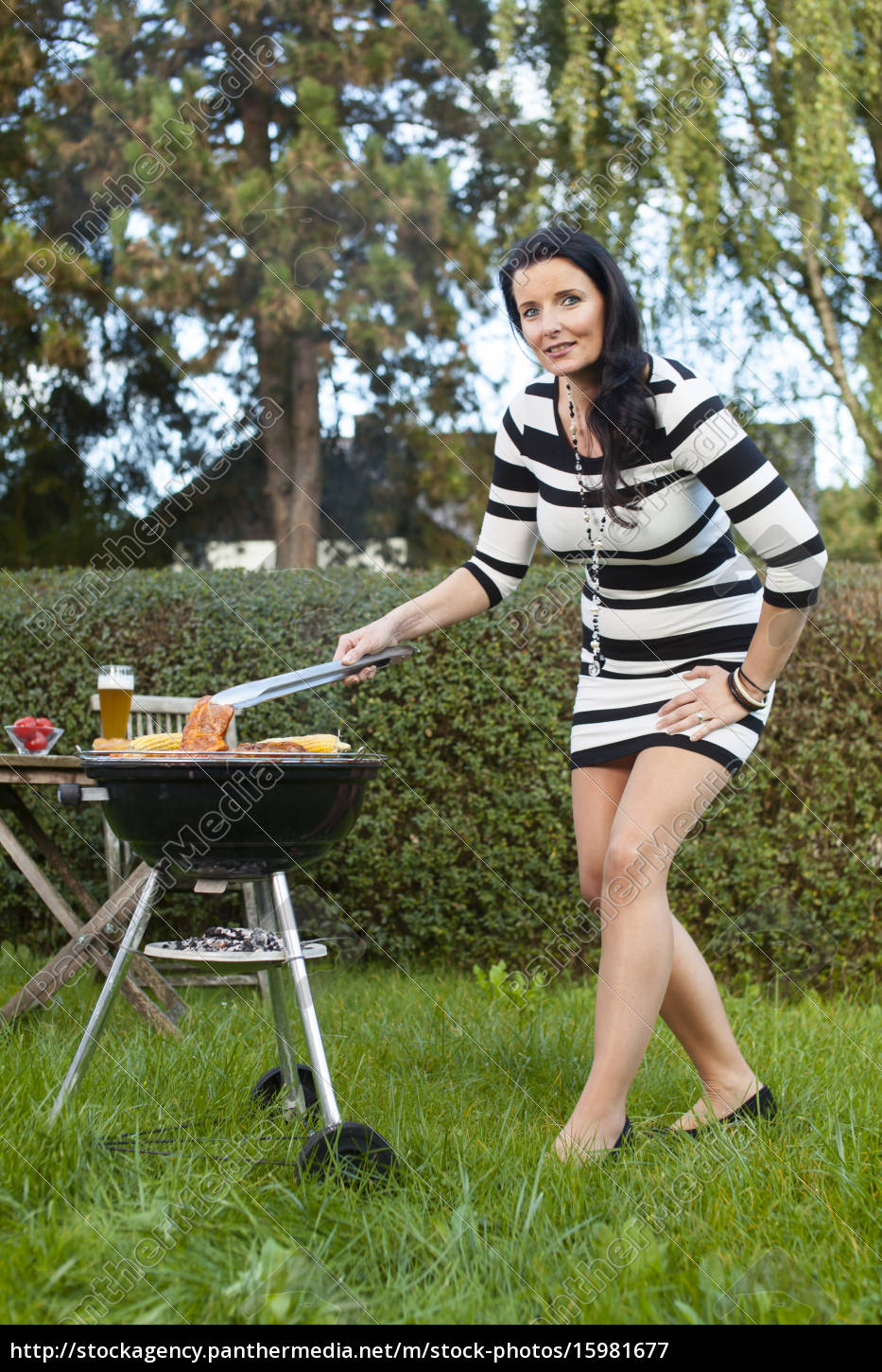 woman, in, the, garden, while, grilling - 15981677