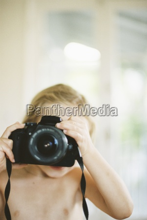 young nude girl taking a picture